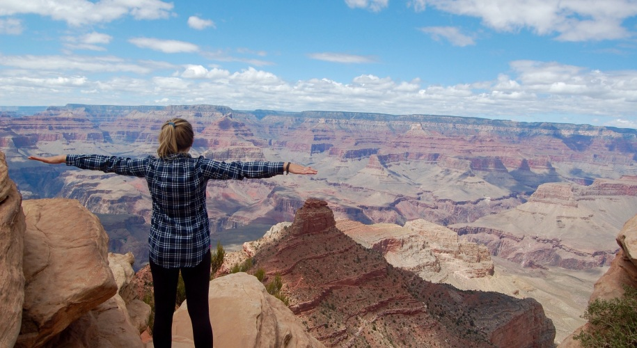 Standing on the rim overlooking the Grand Canyon from OOH AHH Point