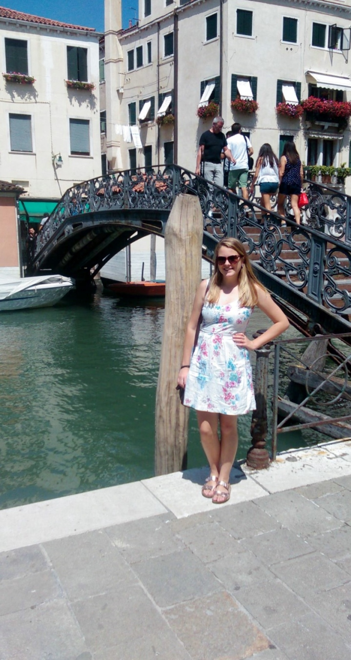 A girl by the canal and bridge in the Jewish Ghetto, Venice City, Italy